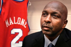 Former Philadelphia 76ers star Moses Malone talks to reporters before the start of the 76ers' game against the Portland Trail Blazers, Friday, March 14, 2003, in Philadelphia. The 76ers' 1982-83 NBA championship team was to be honored at halftime. (AP Photo/George Widman)